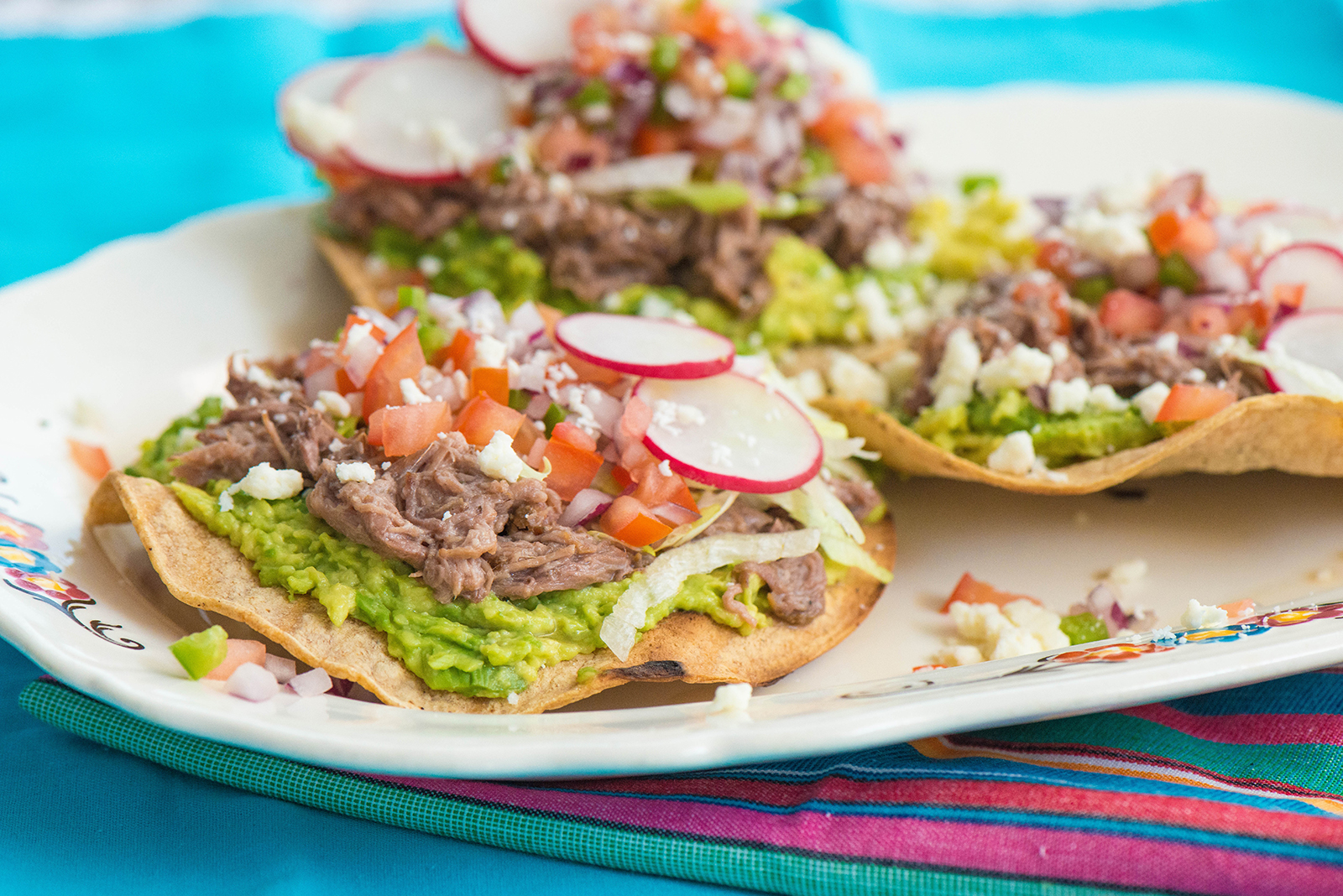 Slow Cooker Shredded Beef Tostadas - Nibbles and Feasts