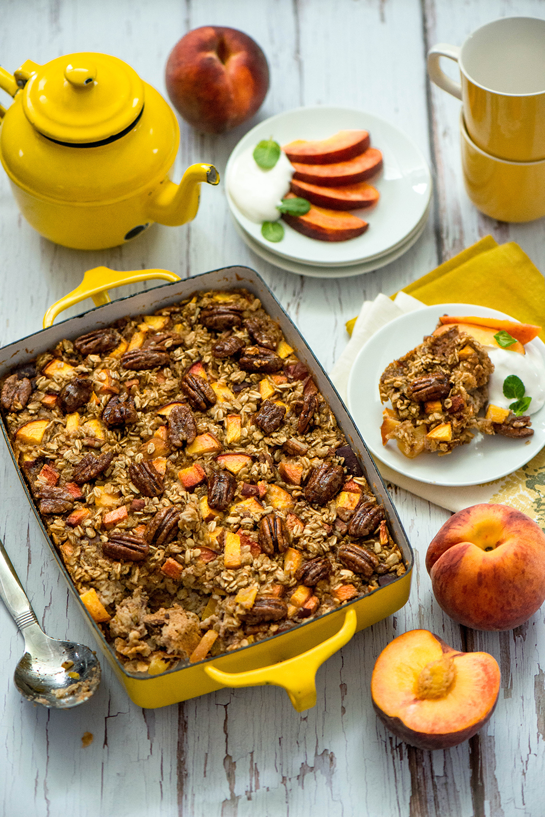 BAKED PEACH OATMEAL WITH GLAZED PECANS NIBBLES AND FEASTS